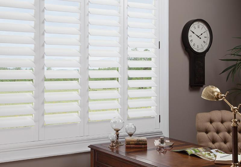 An office room that has interior plantation shutters in Tucson, AZ