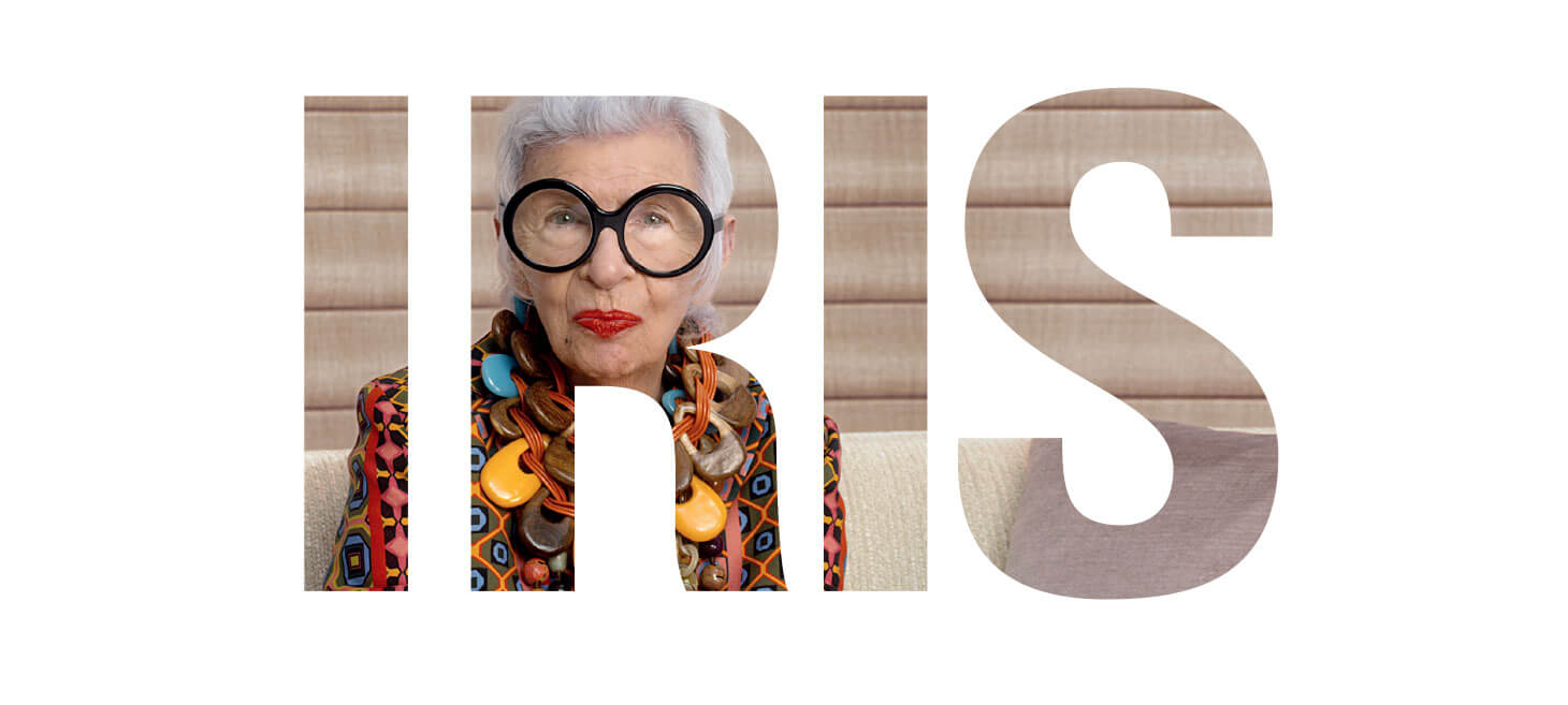 Iris Apfel, wearing big black glasses in a cut out image for PowerView motorized blinds & shades by Hunter Douglas.